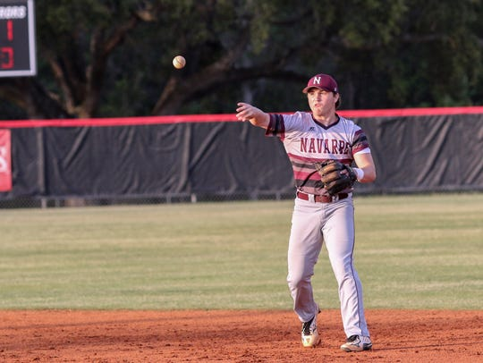 Navarre second baseman Cade Taylor (10) throws the