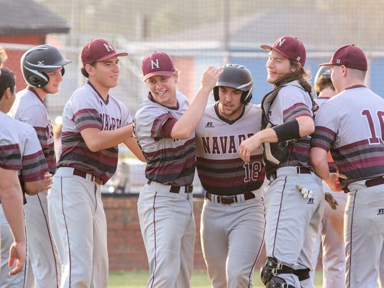 Navarre's Tyler Rebber (18) is congratulated by teammates after hitting a homerun against West Florida Tech Thursday afternoon.