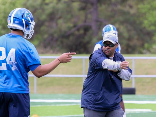 New defensive coordinator Darian Dulin, right, works with defensive back Trent Archie during the University of West Florida football team's first spring practice at UWF's Pen Air Field Saturday morning.