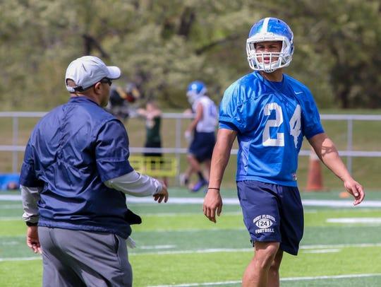New defensive coordinator Darian Dulin, left, works
