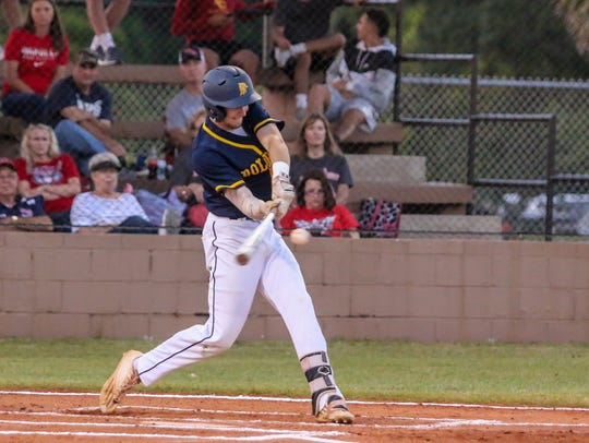 Gulf Breeze's Brandon Schrepf (13) hits a single into