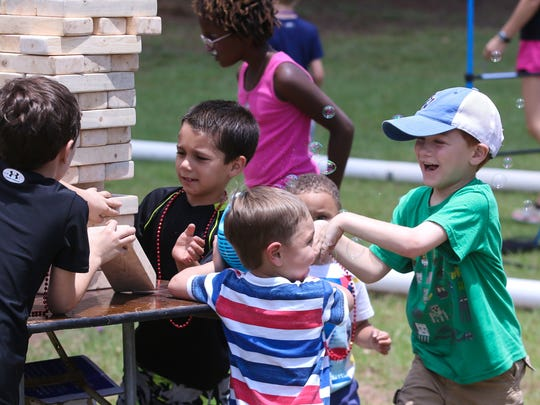 Families enjoy the nice weather while playing games, getting face-painted, and more during last year's Fiesta Children's Treasure Hunt. This year's event is Saturday at Bayview Park.