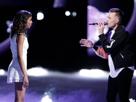 """Aliyah Moulden, left, and Hunter Plake  perform a duet Monday night on """"The Voice."""""""