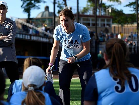 IHA head coach Diana Fasano talks to her team after