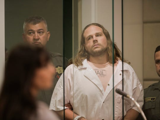 Jeremy Christian enters for a court appearance at Multnomah County Circuit Court in Portland, Ore., on Wednesday, June 7, 2017.  Christian is accused of killing two passengers and wounding a third aboard a light-rail train.