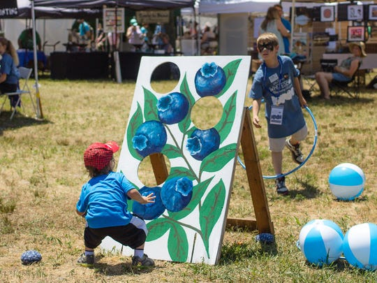 Games inspired by blueberries are part of the fun at the Whitesbog Blueberry Festival.