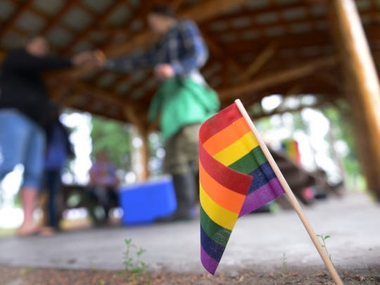 A rainbow flag is placed in the ground for Lesbian, Gay, Bisexual and Transgender Pride Month during the Picnic in the Park at Nussbaumer Park, June 27, 2015, in Fairbanks, Alaska. More than 200 flags were handed out to members of the 354th Fighter Wing and members of the local community. (U.S. Air Force photo by Senior Airman Ashley Nicole Taylor/Released)