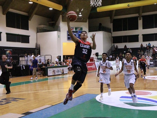 Nathaniel Kyle Gaitan gets an easy two in Team Guam's game against the Marshall Islands on Monday. Guam won 151-34.