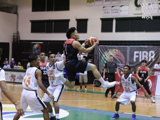 Alschea Olis Grape levitates above the field for two in Team Guam's game against the Marshall Islands on Monday.