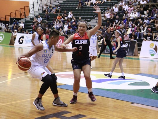 Mia San Nicolas, 9, plays big defense against Palau