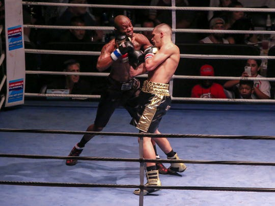 Devin Cushing, red tape, takes on Devin Parker during Island Fights 41 at the Pensacola Bay Center on Saturday, July 22, 2017. Cushing remained undefeated after the judges unanimously scored him the winner after four rounds.