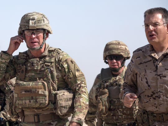 """Maj. Gen. Robert """"Pat"""" White, left, commander of Combined Joint Forces Land Component Command, arrives July 17 for a battlefield circuit at the Besmaya Range Complex in Iraq."""