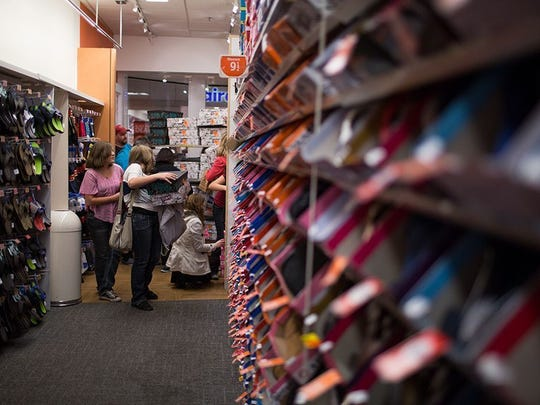 File photo taken in 2014 shows shoppers at a Payless ShoeSource location at the Superstition Springs Center in Mesa, Arizona.