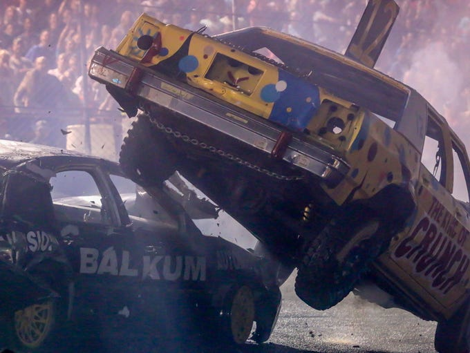 Drivers work to eliminate each other during the demolition