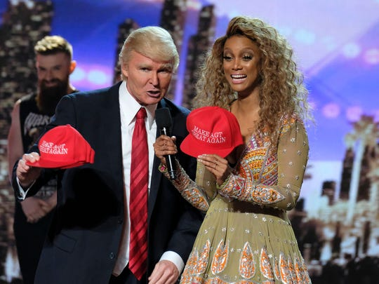 "Singing Trump with ""America's Got Talent"" show host Tyra Banks after he is eliminated during the first Live Results show Aug. 16,  2017."