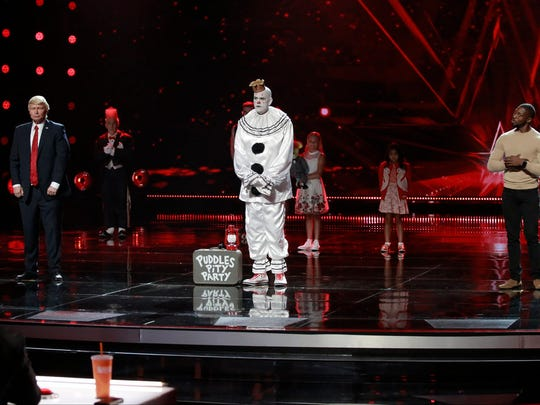 "(l-r) The Singing Trump, Puddles Pity Party, and Preacher Lawson on ""America's Got Talent"" during the first Live Results show Aug. 16,  2017."