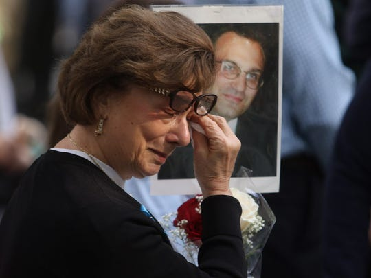 A woman reacts Monday to the reading of the names of those who died on 9/11.
