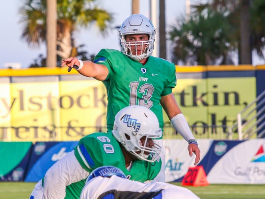 UWF quarterback Mike Beaudry (13) signals to the wide