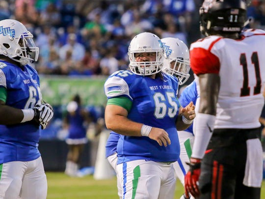 UWF center Devin Gibson (65), a West Florida High School graduate, lines up against Valdosta State at Blue Wahoos Stadium on Saturday, Sept. 23, 2017.
