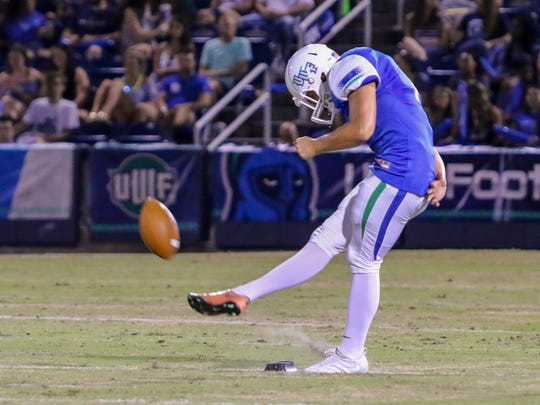 UWF kicker Austin Williams (1) hits a perfect onside kick against Valdosta State to give the Argonauts possession of the ball again at Blue Wahoos Stadium on Saturday, Sept. 23, 2017.