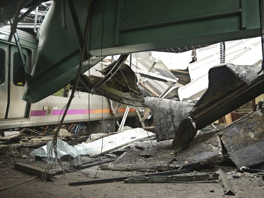 This Oct. 1, 2016, photo provided by the National Transportation Safety Board shows damage done to the Hoboken Terminal in Hoboken, N.J., after a commuter train crash that killed one person and injured more than 100 others last week.
