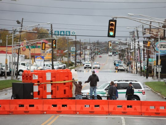 Emergency personnel set up barricades on Route 46 at
