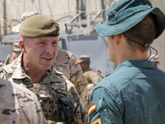 British Army Brig. Gen. Frazer M. Lawrence, deputy commanding general of operations for the Combined Joint Forces Land Component Command, speaks with a Spanish Guardia Civil, Grupo de Accion Rapida trainer, during a visit to the Besmaya Range Complex in August.