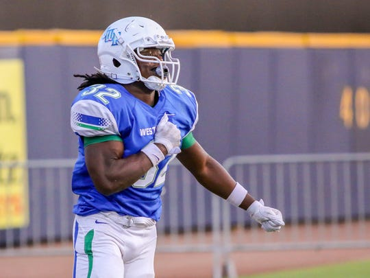 UWF's Anthony Johnson, Jr. (32), a Pace High School graduate, celebrates after scoring a touchdown against Mississippi College at Blue Wahoos Stadium on Friday, Oct. 6, 2017.  The game originally was scheduled for Saturday, but was moved up a day due to concerns about the forecast of Tropical Storm Nate.