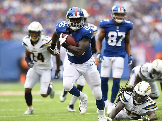 New York Giants running back Orleans Darkwa #26 rushing 23 yards for a touchdown in the first quarter. The Los Angeles Chargers lead the New York Giants 10-9 in the first half on Sunday, October 8, 2017 in East Rutherford, NJ.
