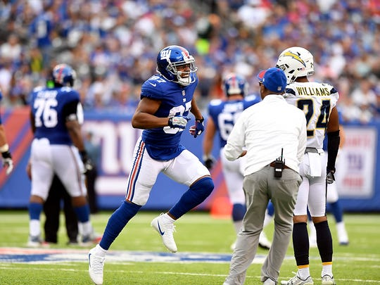 New York Giants wide receiver Sterling Shepard #87 limps off the field in the first half. The Los Angeles Chargers lead the New York Giants 10-9 in the first half on Sunday, October 8, 2017 in East Rutherford, NJ.