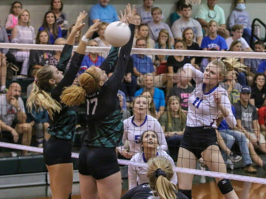 Pace's Gracyn Smith (11) gets a shot past the Crusaders