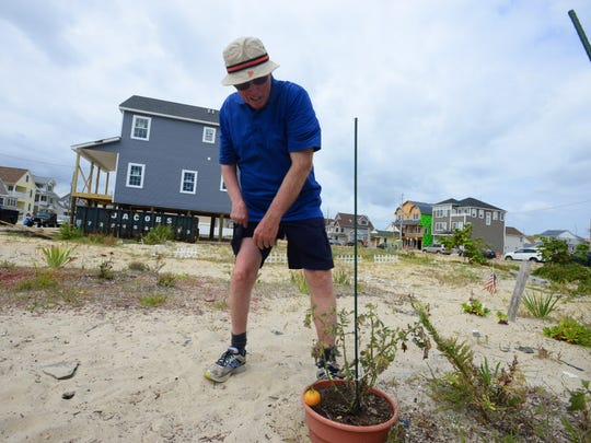 Ortley Beach resident Bill Mullen stands on an empty lot where his house was located at 18 Coolidge Ave. on Aug. 30, 2014. He planted a garden and visits each day.