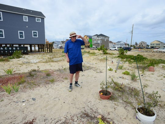 Ortley Beach resident Bill Mullen stands on an empty lot where his house was located at 18 Coolidge Ave. on Aug. 30, 2014. The house he lived in since the late 1950s was washed away by Sandy, leaving only a bare lot, where he planted a small garden.