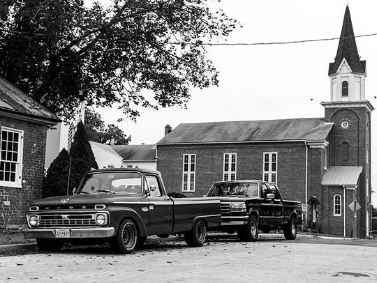 Two older cars in front of St. Paul's Lutheran Church