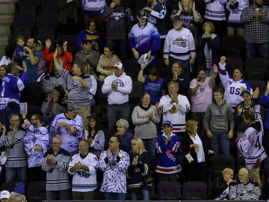 Fans celebrate after Jessyko Bernard (18) scores the Ice Flyers first goal against Mississippi goaltender Tyler Green (35) during the first home game of the season at the Pensacola Bay Center on Friday, October 27, 2017. The Ice Flyers shut out Mississippi 2-0 and have won two straight games to start the season 2-0.