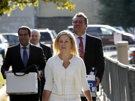 Gov. Chris Christie's former Deputy Chief of Staff Bridget Anne Kelly, center, arrives at Martin Luther King Jr. Courthouse with her attorneys Michael Critchley Jr., right, and Michael Critchley, back second left, for a hearing, Wednesday, Oct. 19, 2016, in Newark, N.J. Three years after gridlock paralyzed a New Jersey town next to the George Washington Bridge for days, two former allies of New Jersey Gov. Chris Christie, Kelly and Bill Baroni, Christie's former top appointee at the Port Authority of New York and New Jersey, are being tried on charges of politically motivated lane closures of the George Washington Bridge.