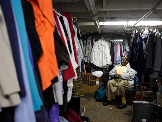 Beatrice Leonard in the clothing closet in the old