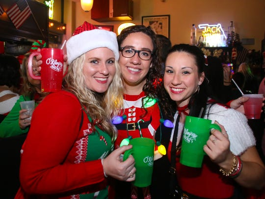 Hundreds of people participate in the 5th annual Santa Pub Crawl sponsored by O'Riley's Irish Pub on Saturday, December 2, 2017. The event raises money and collects toys for Shriners International and Toys For Tots.