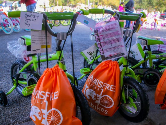 Volunteers helped build more than 400 bicycles at Weiss Elementary School for onbikes Pensacola on Dec. 2, 2017.
