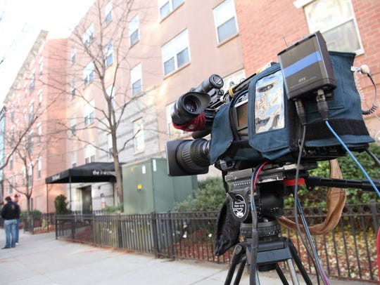 The 1300 block of Grand St is still packed with journalists