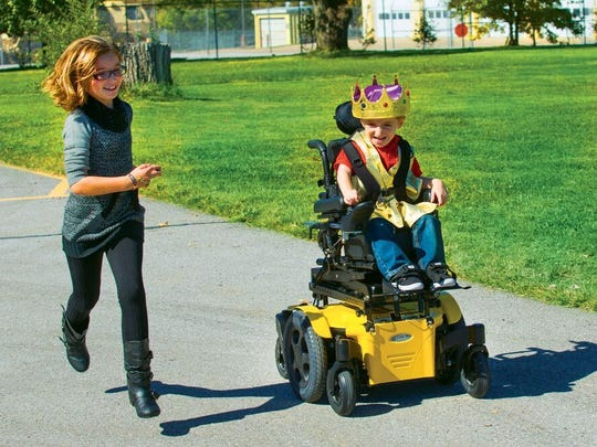 A child uses a complex power wheelchair  from Yellow Sunrise Chair, which is one of Monroe Wheelchair's partners.