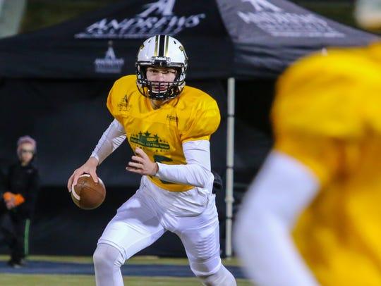 Milton quarterback Aubrey Williams (16) looks for an