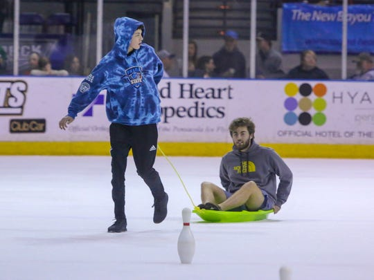 Fans participate in on-ice games in between periods