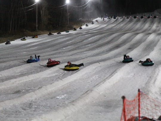 Children come flying fast down Campgaw Mountain snow tubing.
