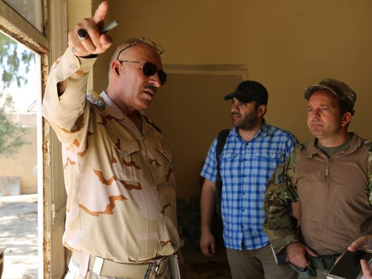 Army Maj. Christopher Evans, with Combined Joint Forces Land Component Command in Baghdad, speaks to Brig. Gen. Jabbar Mustaf Hassoun about future security operations in the region. The 1st Armored Division headquarters is deployed in Iraq in a mission command role.