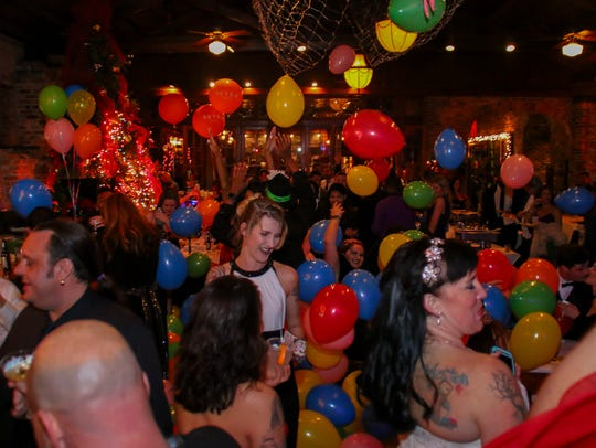 Bar and restaurant employees, and their friends, celebrate their version of New Year's Eve during the annual B.A.R.E. Ball at Seville Quarter last year. The 2019 party is set for Sunday.