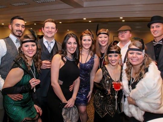 People enjoy the Pirates of Lost Treasure Mardi Gras ball last year. The organization is hosting their 25th anniversary Mardi Gras Flotilla on Saturday.