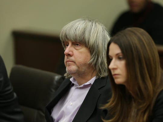 David Turpin listens to the judge as he and wife Louise Turpin are arraigned at the Robert Presley Hall of Justice in Riverside County on Jan. 18, 2018. The Turpin couple are being charged with child endangerment and torturing their children.