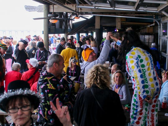Hundreds of people filled the The Dock on Penascola Beach for a previous Krewe of Nauga Mardi Gras Champagne Breakfast & Native Noontime Ball. This year's ball takes place Saturday.
