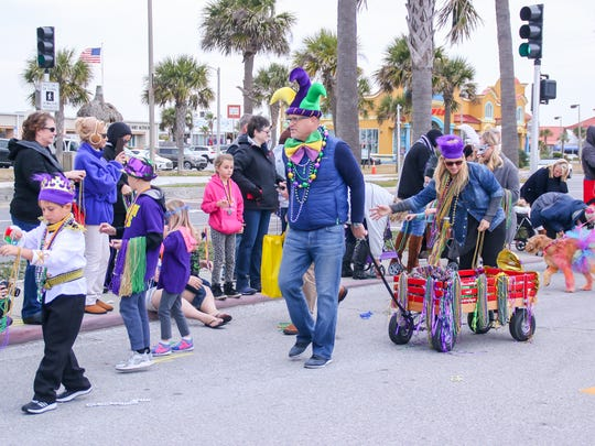 The Kids and Kritters Mardi Gras parade makes its way around the Casino Beach parking lot during last year's event.